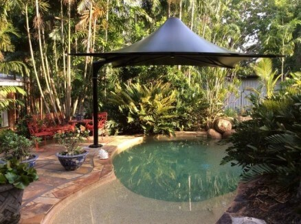 Black Umbrella on Resort's pool
