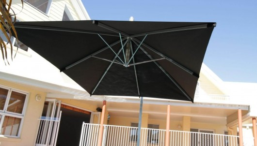 Cantilever Umbrella by a pool